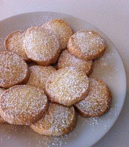 Lemon shortbread cookies with icing sugar.