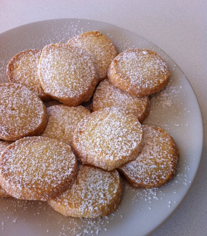 Lemon shortbread cookies with icing sugar.