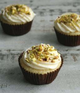 Fresh lemon cupcakes with pistachios.