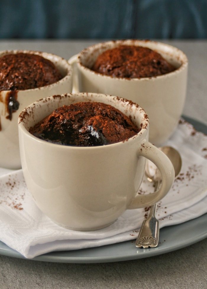 Individual baked chocolate and coconut puddings.