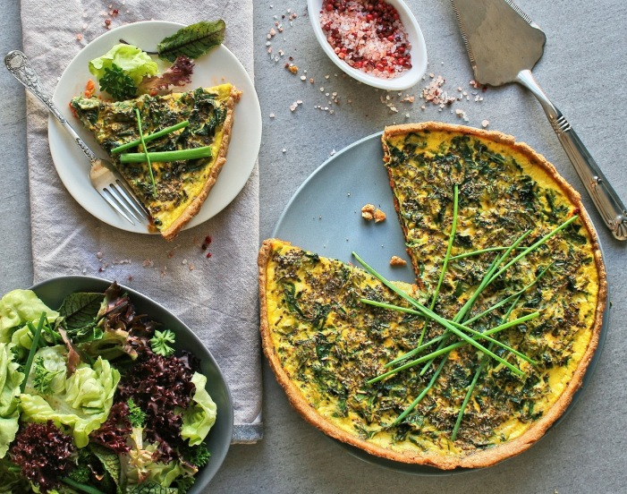 Spring vegetable quiche with sun dried tomato pesto.