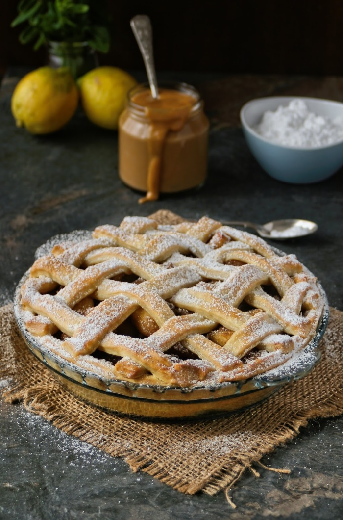 Apple pie with lattice crust and creamy caramel custard.