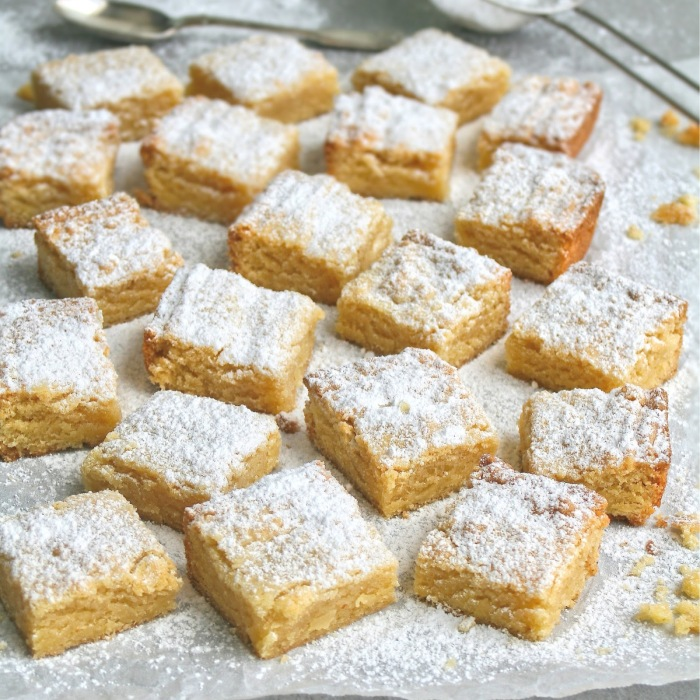Blocks of almond tart dusted with icing sugar.