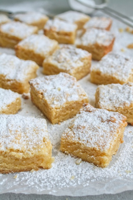 Blocks of almond tart cookies dusted with icing sugar.