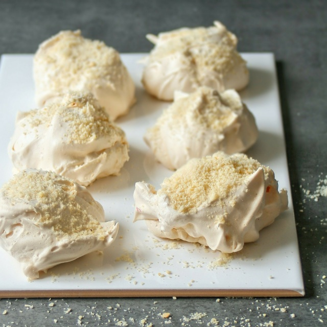 Vanilla bean meringues topped with ground almonds,