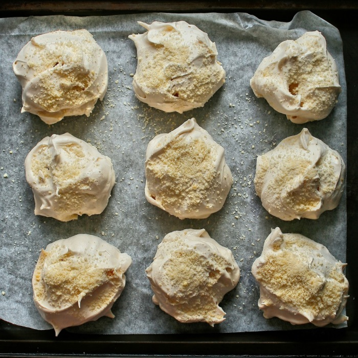 Aerial photo of vanilla bean meringues with almonds.