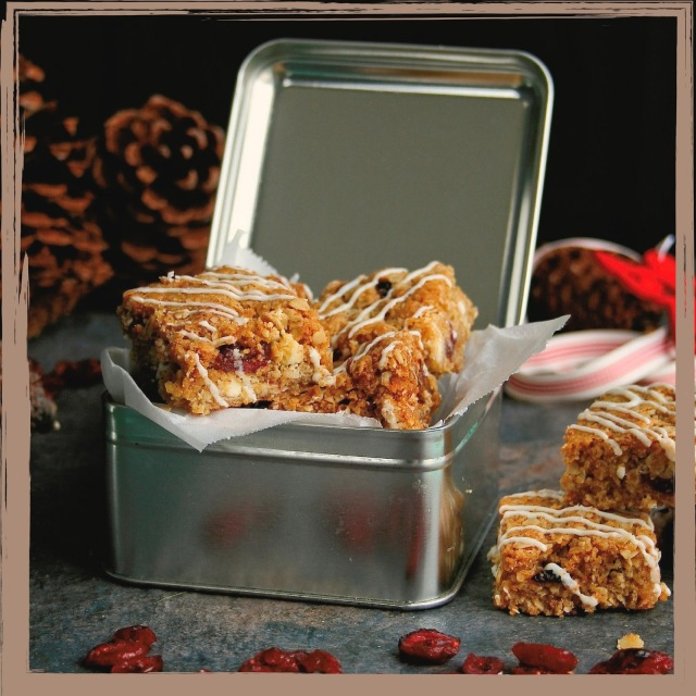 A tin of cranberry and white chocolate crunchies.