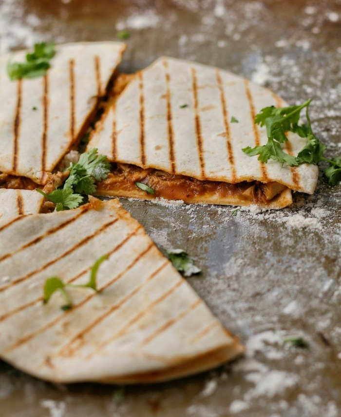 Cheesy chicken quesadillas with coriander.