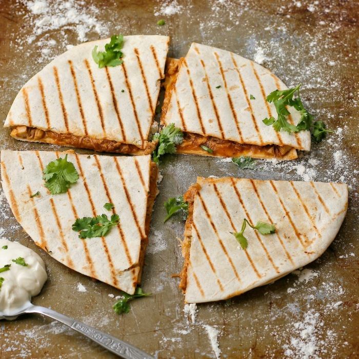 Pulled chicken quesadillas with cheese and coriander.
