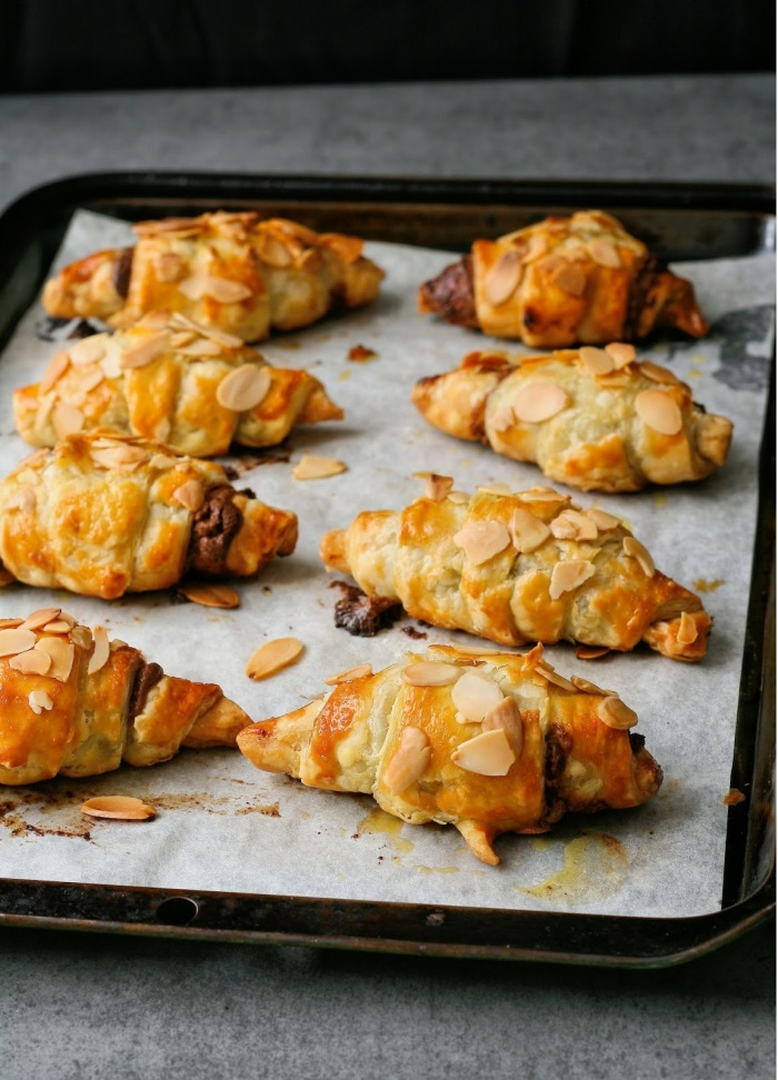 A tray of freshly baked chocolate croissants.