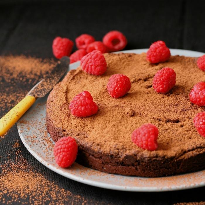Gluten free chocolate cake with raspberries.