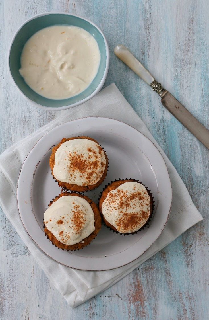 Date and carrot muffins with cream cheese topping.