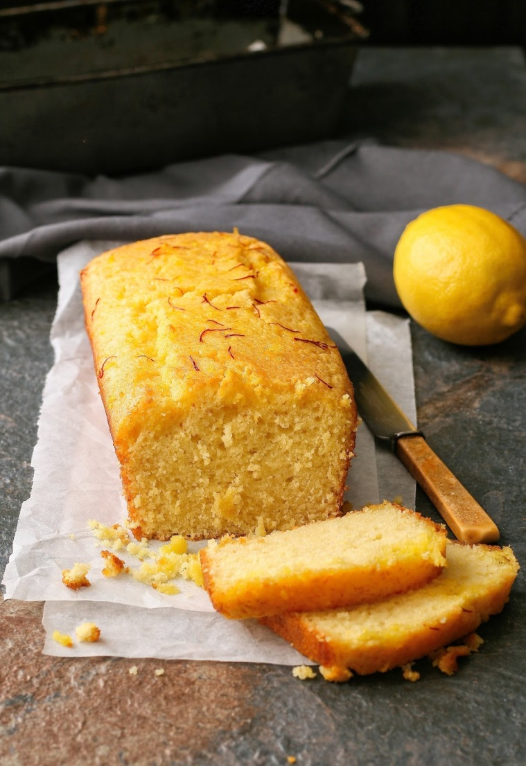 Lemon loaf slices with saffron and cardamom syrup.