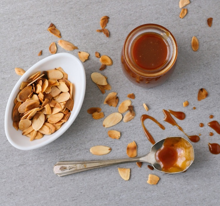 Caramel sauce and toasted almonds.