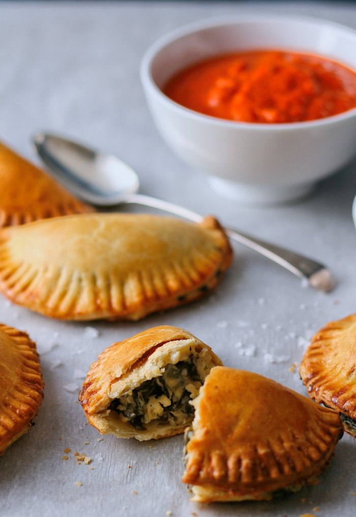 Spinach empanadas with roasted red pepper sauce