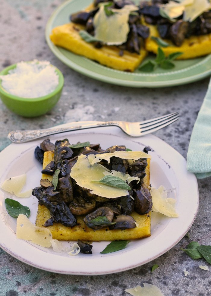 Grilled polenta squares with mushrooms and pecorino.