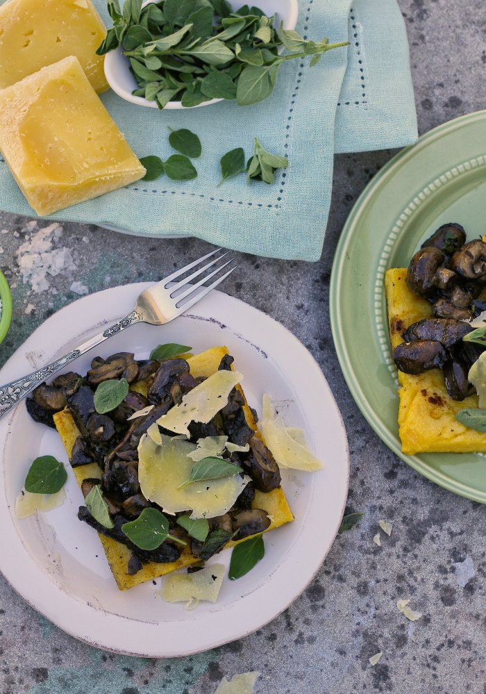 Polenta topped with mushrooms and cheese