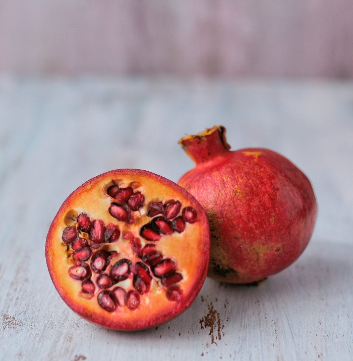 Pomegranates cut in half.