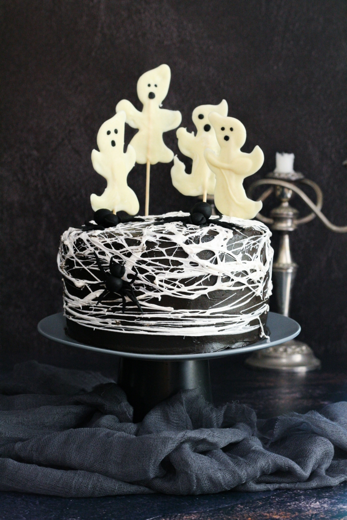 Spider web red velvet cake with chocolate cream cheese icing and chocolate ghosts