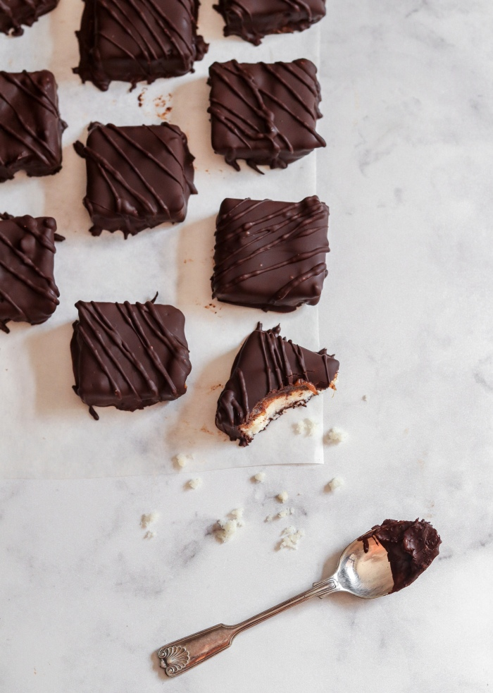 Dark chocolate coconut squares with date caramel